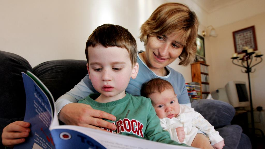 Speech pathologist Gaenor Dixon with her children Andrew and Johanna in 2009.