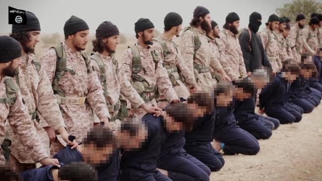 A still from an Islamic State propaganda video released yesterday that allegedly shows members preparing to behead at least 15 men. Picture: AFP Photo/HO/Al-Furqan Media