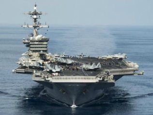 US supercarrier Carl Vinson will arrive in the Sea of Japan in days, Mr Pence said. Picture: AFPSource:AFP