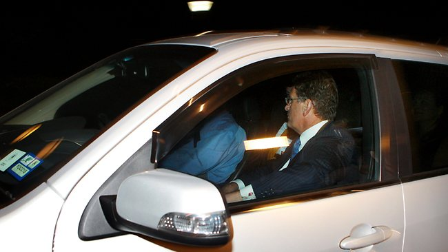 Ted Baillieu avoids the cameras as he heads into Government House to officially resign as premier. Picture: Ian Currie