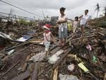Survivors walk through typhoon-ravaged Tacloban city.