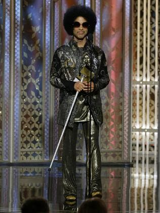 Another 'legend', Prince presents an award at the 2015 Golden Globes.
