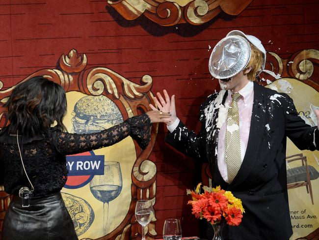 Take that ... Washington hits a 'fake' Donald Trump with a pie to the face. Picture: Darren McCollester/Getty Images for Hasty Pudding