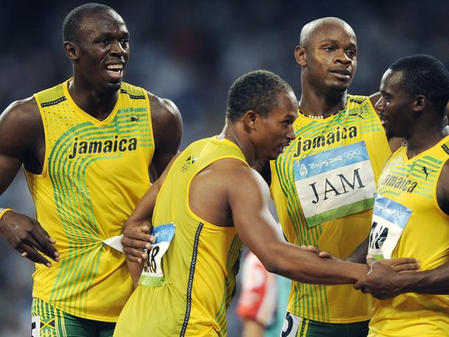 Jamaica's gold medal winning relay team, from left, Usain Bolt, Michael Frater, Asafa Powell and Nesta Carter celebrate after the men's 4x100-metre relay final during the athletics competitions in the National Stadium at the Beijing 2008 Olympics in Beijing. Picture: AP