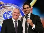 Mitchell Johnson poses with Allan Border after winning the Allan Border Medal during the 2014 Allan Border Medal at Doltone House on January 20, 2014 in Sydney, Australia. Photo: Getty Images