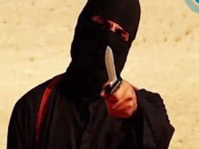 Threats ... in the Sotloff beheading video, a masked militant warned Barack Obama to call off air strikes against IS. Picture: AFP