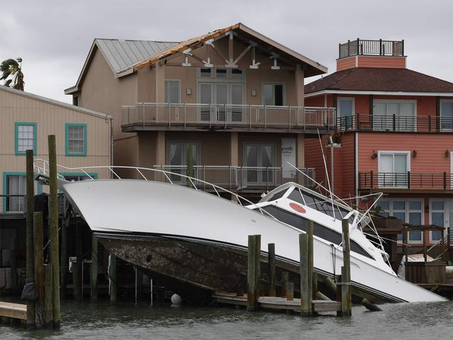 A sunken boat lies submerged in front of houses after Hurricane Harvey hit Port Aransas, Texas. Picture: AFP