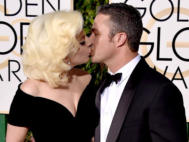 Love birds ... Lady Gaga kisses Taylor Kinney at the 73rd annual Golden Globe Awards. Picture: AP