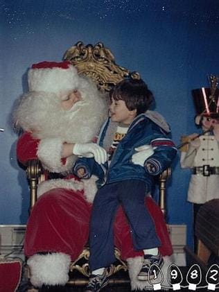 1982 ... Mike sits with Santa around the age of three. Picture: Martin Gray