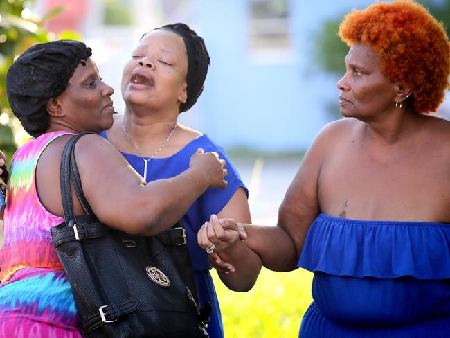 Bennae Robinson (centre), the aunt of shooting victim Kevin Richardson, 30, reacts to the death of her nephew, who was gunned down outside an apartment complex in Miami, Florida. Picture: Angel Valentin/Getty Images/AFP