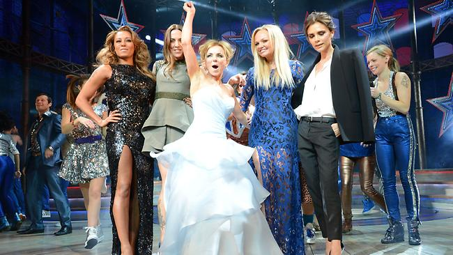 Less than impressed: Victoria Beckham finally reunites with the band on stage. Picture: Rex Features / Splash
