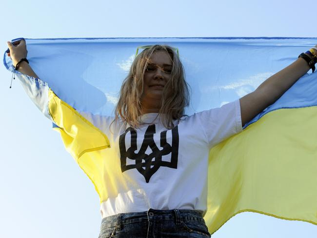 Rally ... a woman holds a Ukrainian flag during a demonstration in the southern Ukrainian city of Mariupol, in the Donetsk region.