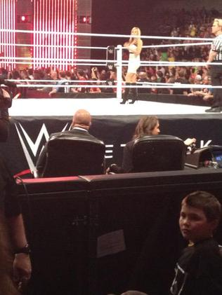 A little boy sneaks up to the ring behind Triple H. Picture: @chrisolds2009