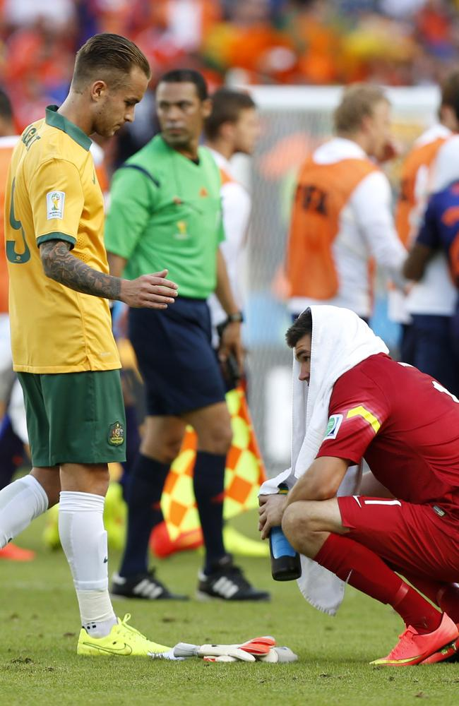 Australia's Adam Taggart, left, reaches out to goalkeeper Mat Ryan.