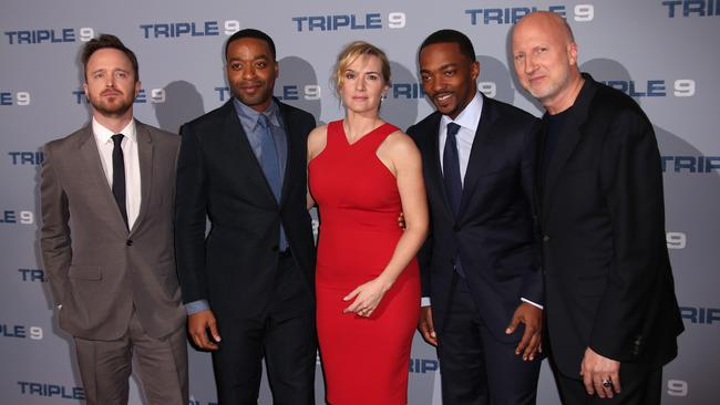 From left: Actors Aaron Paul, Chiwetel Ejiofor, Kate Winslet, Anthony Mackie with director John Hillcoat at the London premiere of Triple 9. Picture: Joel Ryan/Invision/AP