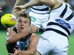 Round 6: Ollie Wines gets his hand ball out against Geelong at Adelaide Oval. Picture: Sarah Reed