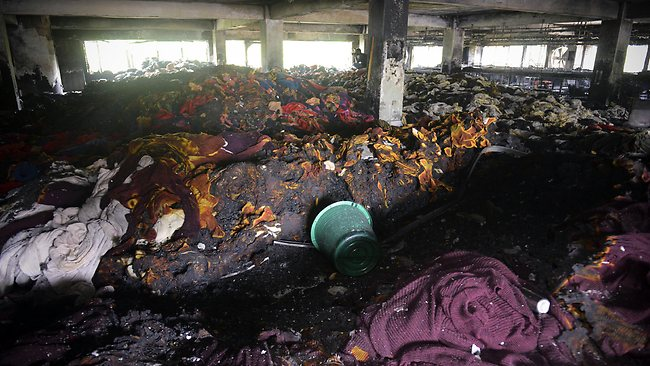 Burnt clothing lies in piles inside a garment factory that caught fire in Dhaka, Bangladesh, Thursday, May 9, 2013. Picture: AP
