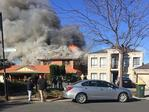 Massive fire rips through suburban home