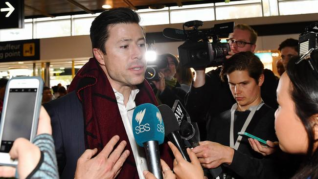 Former Melbourne footballer Andrew Leoncelli in the arrivals terminal. Picture: Jake Nowakowski