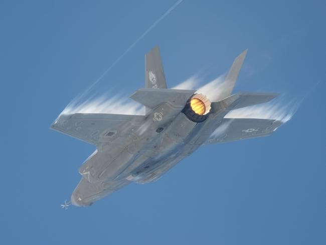 An F-35 undergoes transonic testing, producing shockwaves. The Pentagon stopped delivery of new aircraft last year when it found corrosion at the point where carbon fibre panels joined the aluminium airframe. Picture: US DoD