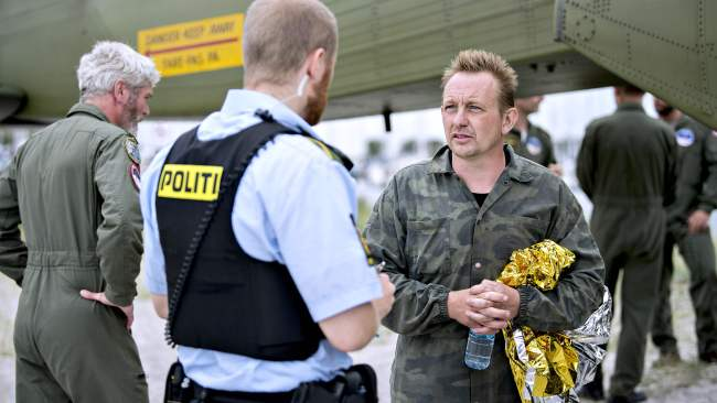 Madsen talks to police after returning to shore the day after Wall disappeared. Photo: AFP PHOTO / Scanpix Denmark / Bax Lindhardt