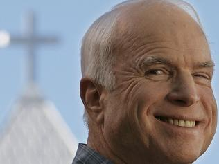 26/10/2008 WIRE: Republican presidential candidate Sen. John McCain, R-Ariz., smiles as Sen. Lindsay Graham, R-S.C., introduces him at a campaign rally in Mesilla, N.M., Saturday, Oct. 25, 2008. (AP Photo/Stephan Savoia)
