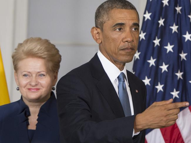 Not to be messed with ... President Dalia Grybauskaite, pictured with US President Barack Obama in Estonia, has a black belt in karate.