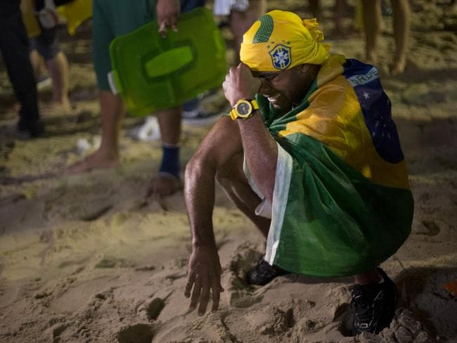 This fan is inconsolable after the crushing 7-1 defeat.