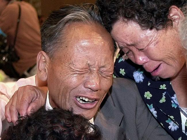 North Korean man Ri Sang-un crying with his sisters in Seoul during their 2000 reunion after 50 years of separation following the Korean War
