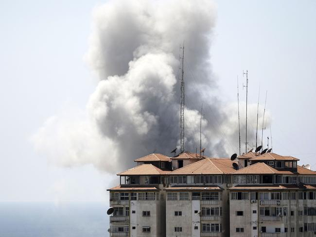 Air strike ... Smoke billows from a building hit by Israeli fire in Gaza City. Picture: Mohammed Abed