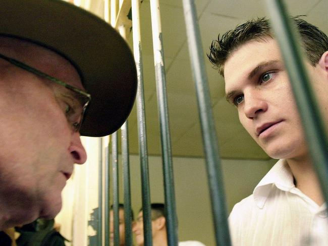 Faced death penalty ... Bali Nine drug courier Scott Rush talks to his father, Lee Rush, before his trial.