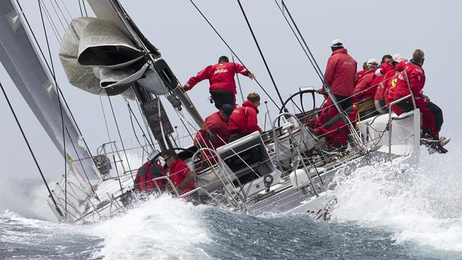 Wild Oats thunders through the water as her crew works on the technique before race day.