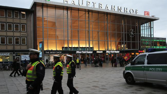 German police patrol in front of the central railway station in Cologne on Monday.