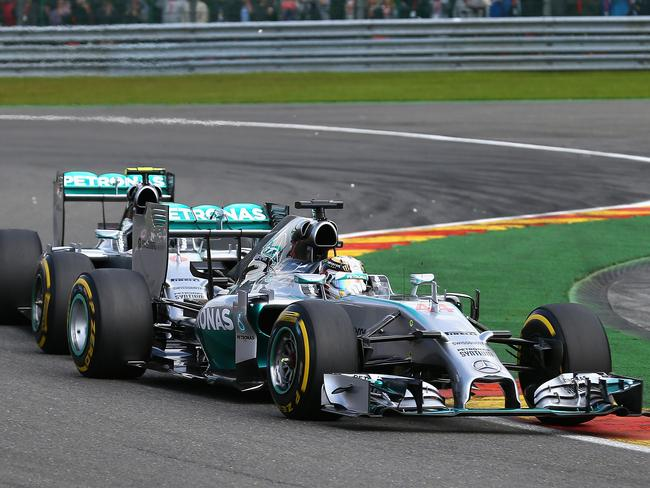 Debris flies after Nico Rosberg made contact with Mercedes teammate Lewis Hamilton.