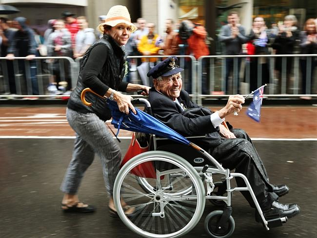 Harrold Hobson, 94, is pushed down George St in his wheelchair. He flew the last Mosquito in Brussels in WW2.