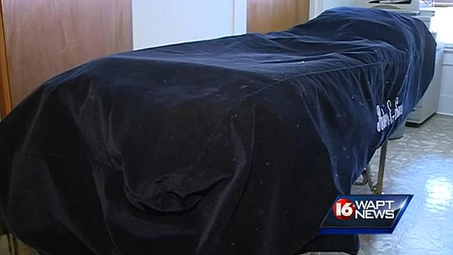 Still alive ... Funeral workers were about to embalm Williams, until they found him wriggling in this body bag. Picture: WAPT News