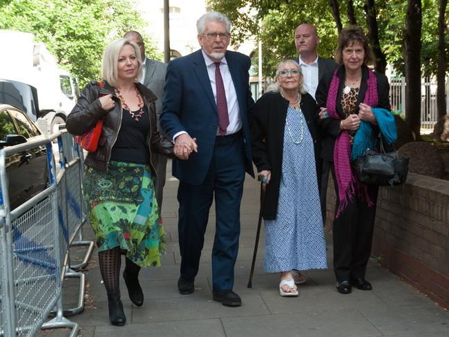 Rocky relationship ... Rolf Harris arrives at Southwark Crown Court with daughter Bindi, wife Alwen and niece Jenny on June 17, 2014, for his indecent assault trial. Picture: Terry Scott