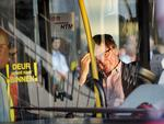 A relative of a passenger on flight MH17 waits in a bus to be transported to an unknown location to receive more information, at Schiphol Airport in Amsterdam, Picture: AP