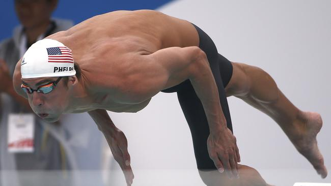 Michael Phelps of the U.S. dives at the start of his men's 100m freestyle heat on Friday.