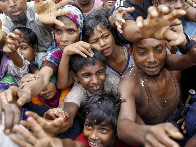 Refugees fight to be at the front of the aid queue at a refugee camp in Bangladesh. Picture: K.M. Asad