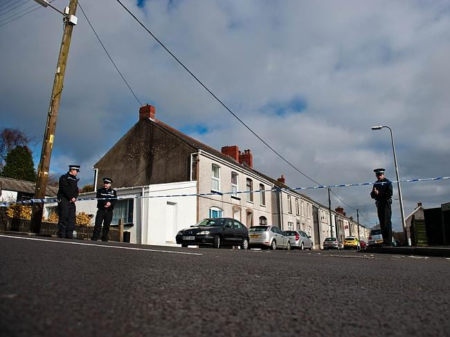 Police guard the New Road, Pontyberem property where six-day-old Eliza-Mae Mullane was ma
