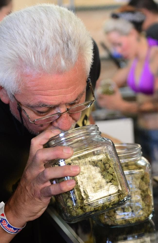 Taking a whiff ... a card-carrying medical marijuana patient has a sniff of the buds in glass jars on display.