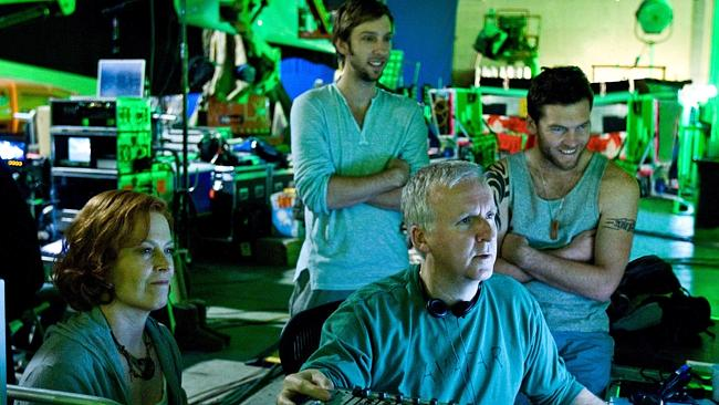 James Cameron reviews a scene with actors Sigourney Weaver, Joel David Moore and Sam Worthington during the filming of, 'Avatar'.