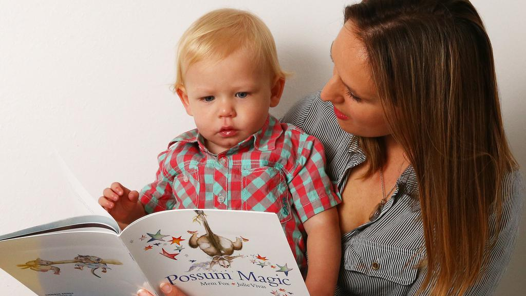 Annika Smith, 31, reads classics from The Great Australian Storybook Collection with son Theo Smith, 1. Picture: Liam Kidston