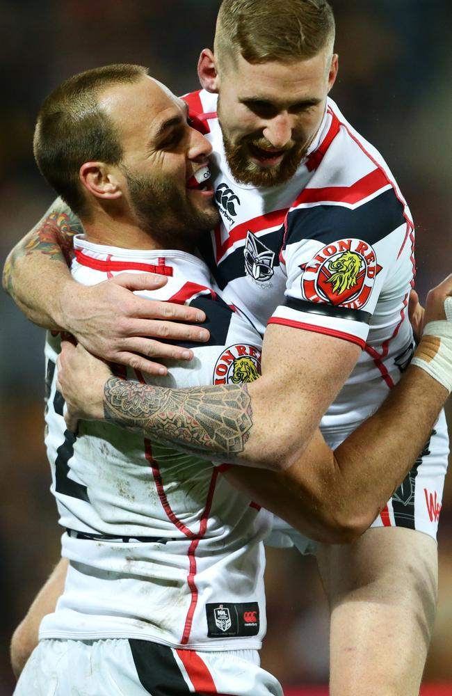 Simon Mannering of the Warriors celebrates a try.