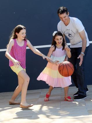 Luke Jardine, with daughters Isabelle 11 and Kate 7, attributes a healthy, active lifestyle to him beating the odds. Pic: Glenn Barnes