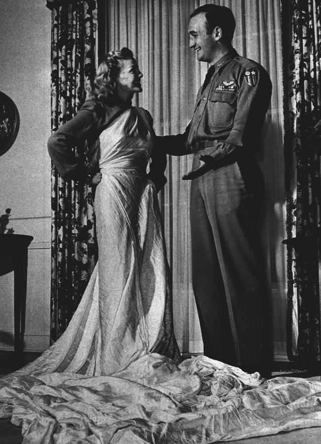Elyse Knox, with husband-to-be footballer Tom Harmon, draped in the parachute that saved his life and became her wedding dress in 1944. Picture: AP