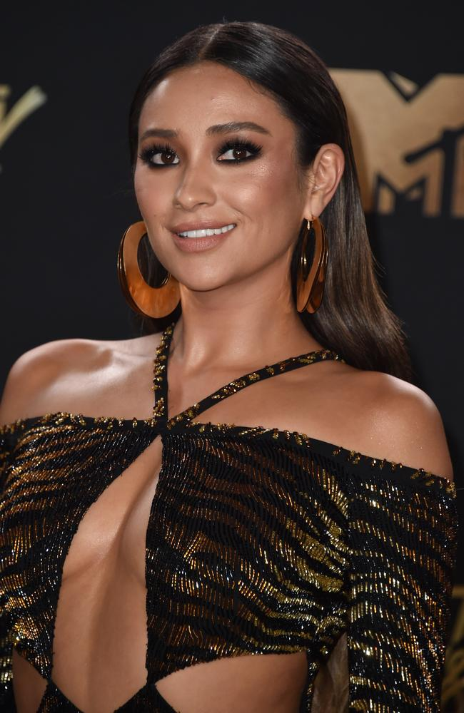 Shay Mitchell showed her wild side in an animal print frock.