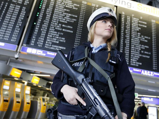 A German police officer guards a terminal in Frankfurt, Picture: AP Photo/Michael Probst.