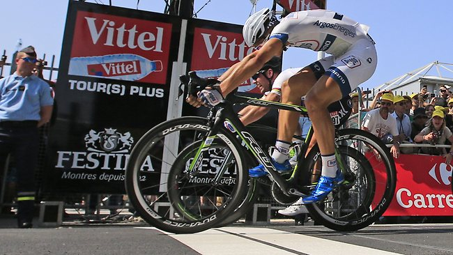 Marcel Kittel edges in front of Mark Cavendish as they hit the line on stage 12 of the Tour de France.